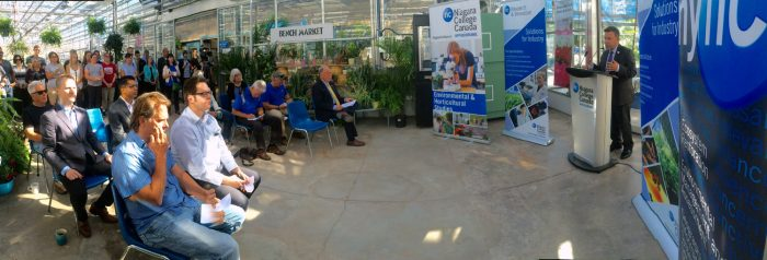 Al Unwin, associate dean of Niagara College's School of Environmental and Horticultural Studies, addresses a crowd gathered at the Niagara College Greenhouse on July 26 for the launch of the College's new Commercial Beekeeping Graduate Certificate program.