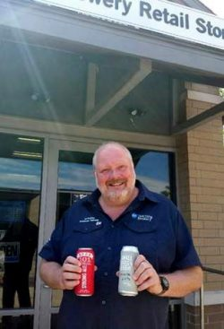 Niagara College brewmaster and professor Jon Downing with  award-winning Niagara College Teaching Brewery beers: Beer 101 Strong, which won bronze at the U.S. Open Beer Championships, and 16-73 Pils, which won gold at the U.S. Open College Beer Championships.
