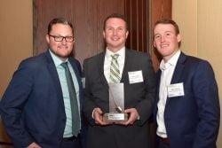 Mike McGarragan, Shawn Jordan and Jesse Langlois accepting the 2016 Reinvest Brownie Award on behalf of Walker Environmental.