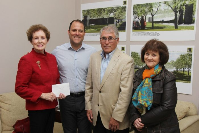 Karen Hunt and Carol Reid, relatives of father and son Elzear and Leo Lynch who died on the same day in 1925 while building the Welland Canal make a donation to the Welland Canal Fallen Workers Memorial to Mayor Walter Sendzik and campaign chair Greg Wight on behalf of the Lynch family.