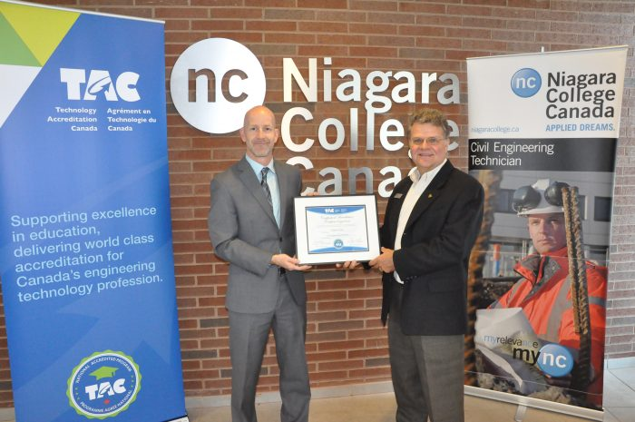 TAC Executive Director Richard Stamper presents the TAC national program accreditation certificate to Gilles Laroche, Program Coordinator, Civil Engineering Technician at Niagara College.