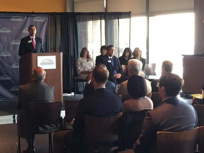 Grant Loomis, Vice President of Government Affairs for the Buffalo Niagara Partnership, speaks Thursday morning inside the Lexus Club at KeyBank Center during his organization's release of its annual report.