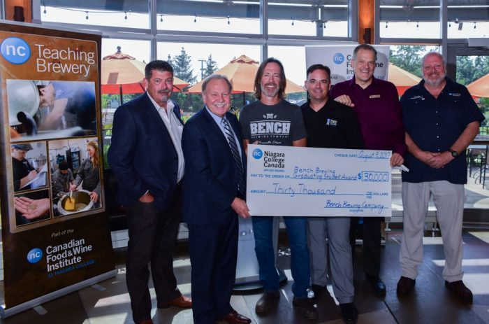 Matt Giffen, president of Bench Brewing Company (third from left) presents a $30,000 donation to Niagara College president Dan Patterson (second from left) to establish the Bench Brewing Graduating Student Award. Pictured (from left) are Steve Gill (Niagara College Learning Enterprises Corp. general manager), Dan Patterson (NC president), Matt Giffen (president, Bench Brewing Company), Gary Torraville (NC Canadian Food and Wine Institute associate dean), Craig Youdale (NC Canadian Food and Wine Institute dean), and program professor Jon Downing (NC Brewmaster and Brewery Operations Management).