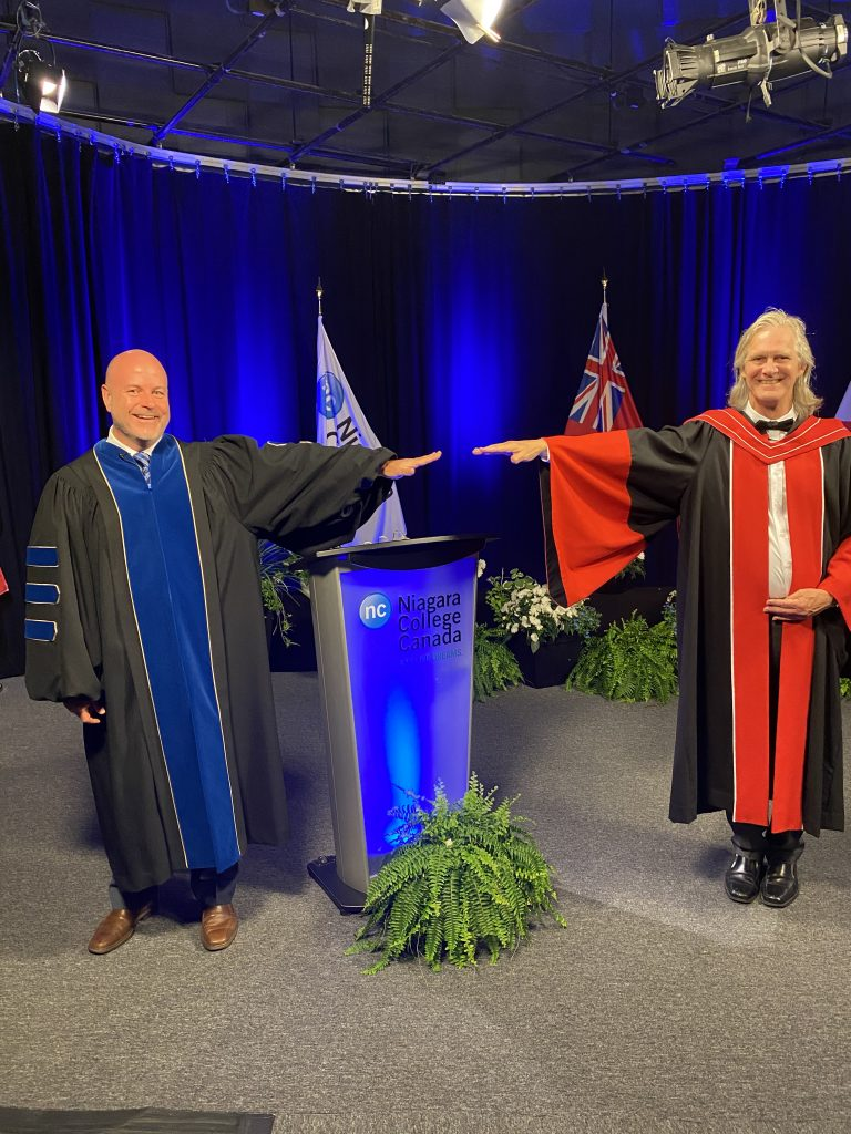 NC president Sean Kennedy and vice president, Academic and Learner Services Steve Hudson stand apart at a safe distance, ready for the ceremony to begin at the Welland Campus on the afternoon of June 15.